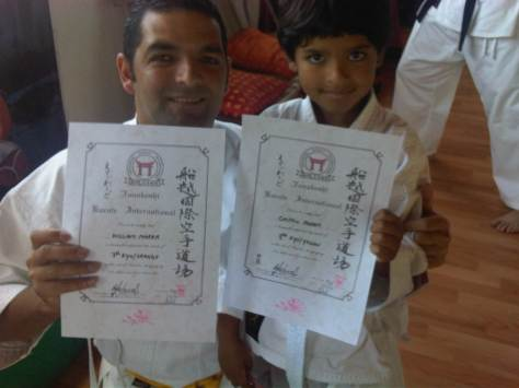William and Griifin with their certificates